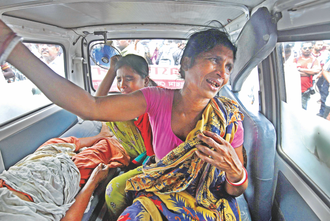 Relatives of a stroke-hit patient are in tears as they sit helpless in an ambulance in front of Dhaka Medical College Hospital around 2:00pm yesterday. They were unable to enter the hospital as its gates were locked following a clash between a patient's attendants and intern doctors.   Photo: Courtesy
