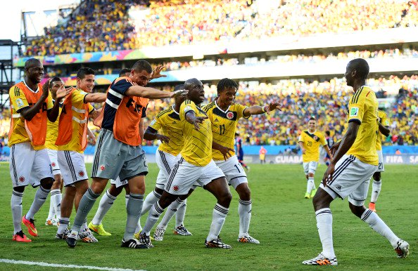 Juan Guillermo Cuadrado (2nd R) of Colombia celebrates scoring his team's first goal with his teammates during the 2014 FIFA World Cup Brazil Group C match between Japan and Colombia at Arena Pantanal on June 24, 2014 in Cuiaba, Brazil. Photo: Getty Images