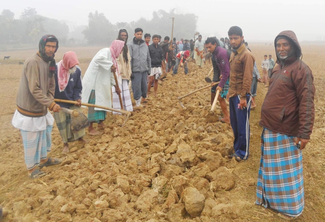 People of Protapi village in Komolganj upazila of Moulvibazar join hands to renovate the road in their area as the authorities concerned did not take any step in this regard despite several pleas in the last two years. PHOTO: STAR