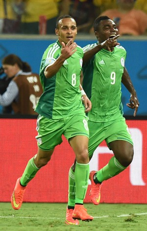 Nigeria forward Peter Odemwingie (L) dealt the killer blow to Bosnia and Herzegovina at the Arena Pantanal on Saturday. PHOTO: AFP