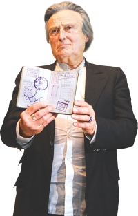 French journalist Philippe Alfonsi, showing his passport containing a Bangladesh visa, Photo: Palash Khan