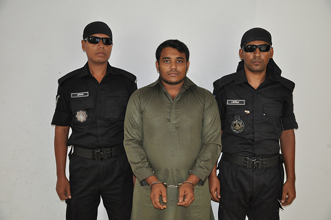 Rapid Action Battalion members produce Omar Farroque Limon (C), son of the owner of the launch Pinak-6 that capsized in #Padma, before journalists after arresting him in Khilkhet area, Dhaka early Friday. Photo: Press release