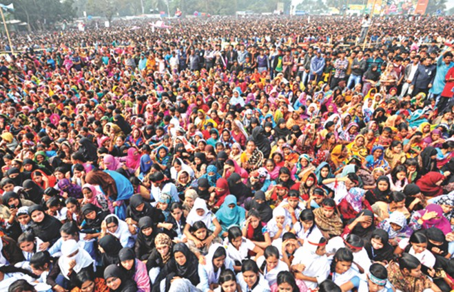 Prime Minister and Awami League President Sheikh Hasina addresses a massive campaign rally at Bhanga Biswa Road Balur Math in Faridpur yesterday. Photo: BSS