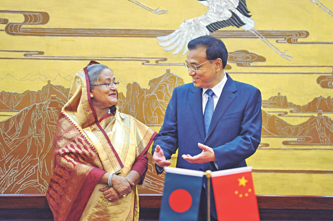 Prime Minister Sheikh Hasina talks with Chinese Premier Li Keqiang as they attend a signing ceremony of agreements at the Great Hall of the People in Beijing yesterday. Photo: AFP