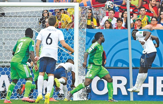 France midfielder Paul Pogba (R) heads in the first goal against Nigeria in the 79th minute of their World Cup round of 16 game at the Mane Garrincha National Stadium in Brasilia on Monday. Photo: REUTERS