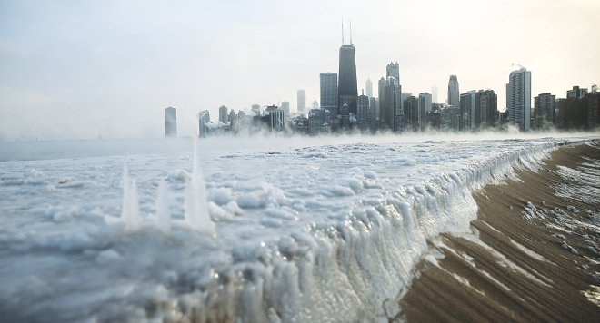 Ice builds up along Lake Michigan at North Avenue Beach as temperatures dipped well below zero in Chicago, Illinois, yesterday. Photo: AFP