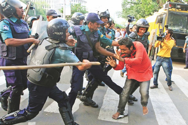 Another campaigner being beaten by the anti-riot policemen. Photo: Palash Khan