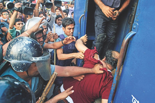 Police push one of the five arrested activists into a prison van.  Photo: Palash Khan