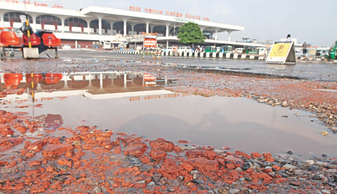 The sorry state of a road in front of the Shahjalal International Airport, the country's prime airport. The repairs that had been done did not stick for even 15 days. The photo was taken two days ago. Photo: Star