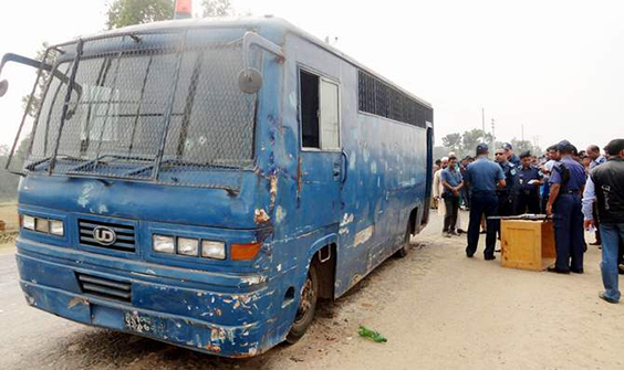 This February 23 photo shows policemen scrunitising clues near a prison van in Trishal upazila of Mymensingh where an armed gang ambushed the vehicle and snatched away three convicted JMB militants. Photo: Banglar Chokh