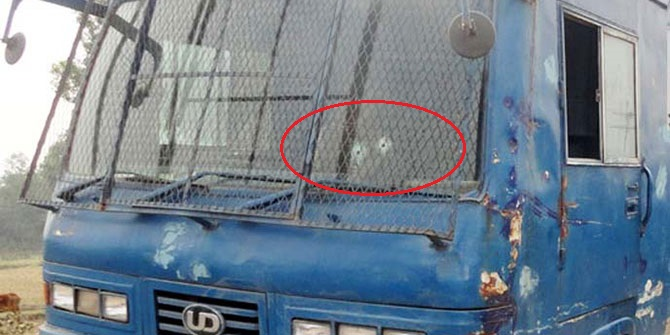 Two bullet holes on the windscreen of the prison van (red circled) that came under attack at Trishal in Mymensingh Sunday morning. Three convicted JMB activists were snatched away and a policeman was killed during the attack. Photo: Banglar Chokh