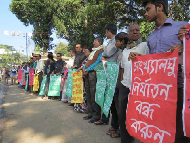 Different organisations in several districts yesterday stage protests against attacks on Hindus in Jessore and some other districts by BNP and Jamaat-Shibir men during and after the January 5 parliamentary elections. Photos show human chains in Rangpur. Photo: Star