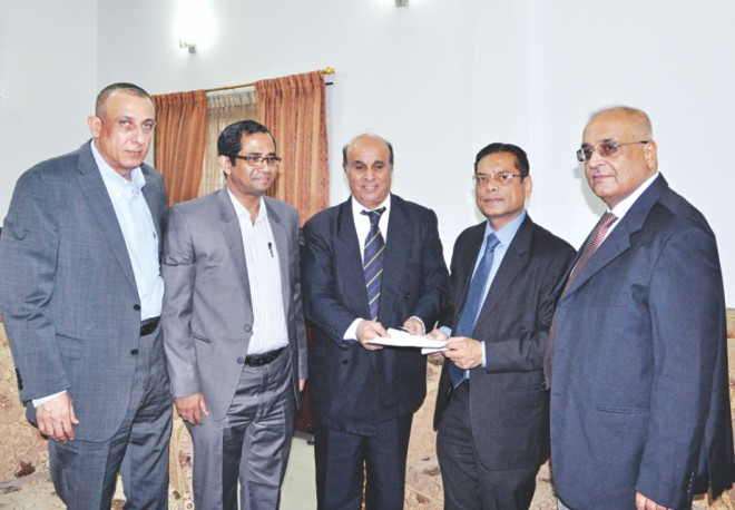 CPD Executive Director Mustafizur Rahman, second from right, hands over a Tk 2,00,000 donation for the Gazans to Palestinian Ambassador Shaher Mohammad at the latter's office in the capital. Photo: Star