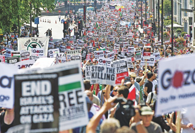 Around 10,000 demonstrators march through the streets of London yesterday calling for an end to violence in Gaza. Photo: AFP