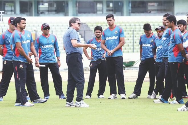 National cricketers observe performance psychologist Phill Jauncey, who has been brought in on a two-day programme by the BCB, at the Sher-e-Bangla National Stadium yesterday. The Tigers spent around four hours with the Australian before heading into training. Photo: Star