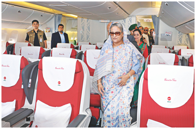 Prime Minister Sheikh Hasina takes a look inside the new aircraft. . Photo: BSS