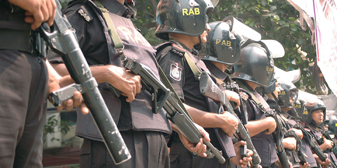 This undated file photo shows Rab men standing guard in the capital.