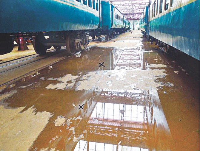 Rainwater seeps through the newly reconstructed roofs of several 'mini units' at Saidpur railway workshop. Photo shows two points of a unit where water trickles down its shed. PHOTO: STAR
