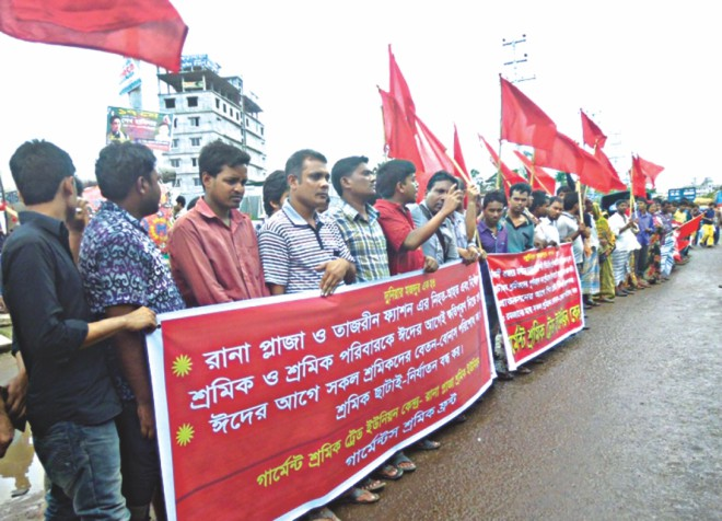 Survivors and families of those who died in the Rana Plaza collapse form a human chain at the site in Savar demanding compensation before Eid.  Photo: Star