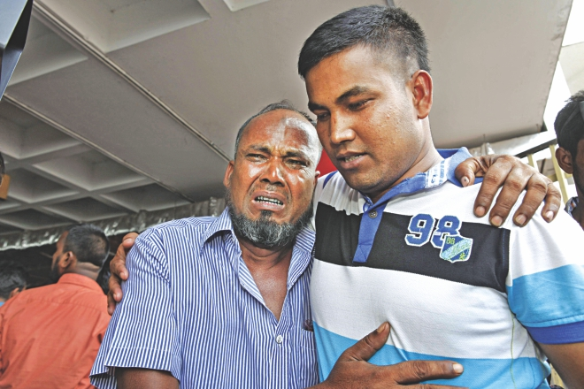 Rasu Sheikh cannot hold back tears seeing his son Selim Sheikh at Shahjalal International Airport in Dhaka yesterday. Selim is one of the 15 Bangladeshis who had been held in captivity for 24 days in conflict-torn Iraq. Photo: Rashed Shumon