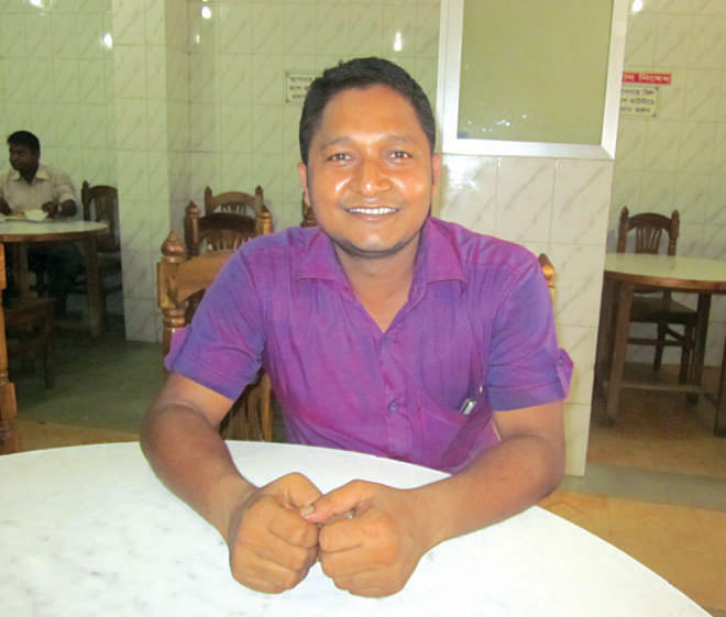When his shift as a waiter at the Hotel Samrat is done, Emon Hossain moves about town with his friends. Photo: Andrew Eagle