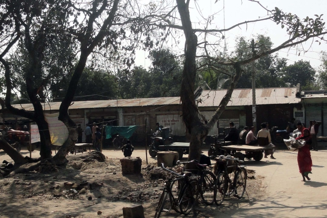 Shops and houses of Hindus, damaged and torched by Jamaat-Shibir and BNP men at Kornai village in Sadar upazila of Dinajpur on the election day on January 5, were rebuilt and handed over to the owners yesterday. Photo: Star