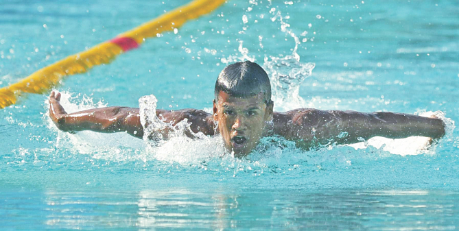 Mohammad Ariful Islam on his way to winning the breaststroke gold, one of the five he won on the second day, of the Cotton Group 30th National Age Level Swimming Competition at the National Swimming Complex in Mirpur yesterday. PHOTO: STAR