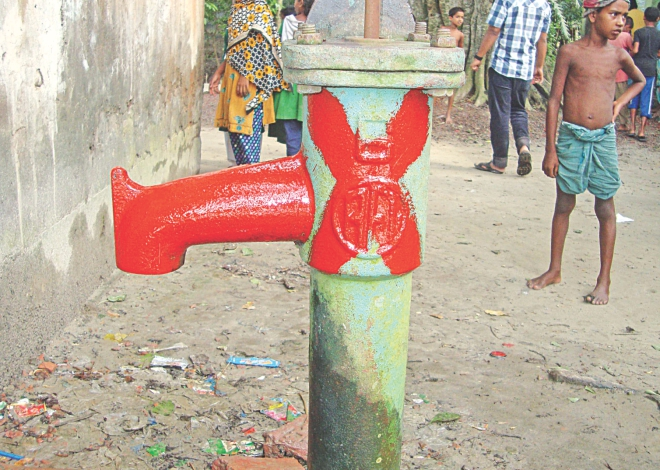 This red-marked tube-well on the premises of Kurighar Government Primary School in Nabinagar upazila under Brahmanbaria district is one of over 62 thousand arsenic contaminated water sources in the district. PHOTO: STAR