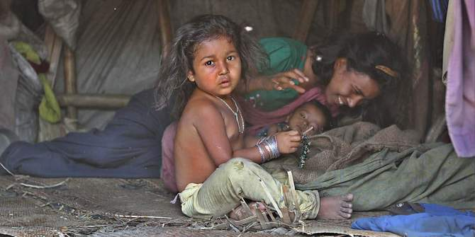 This Star file photo shows a family of Rohingya refugees inside their shanty in the Outer Stadium area of Chittagong city.