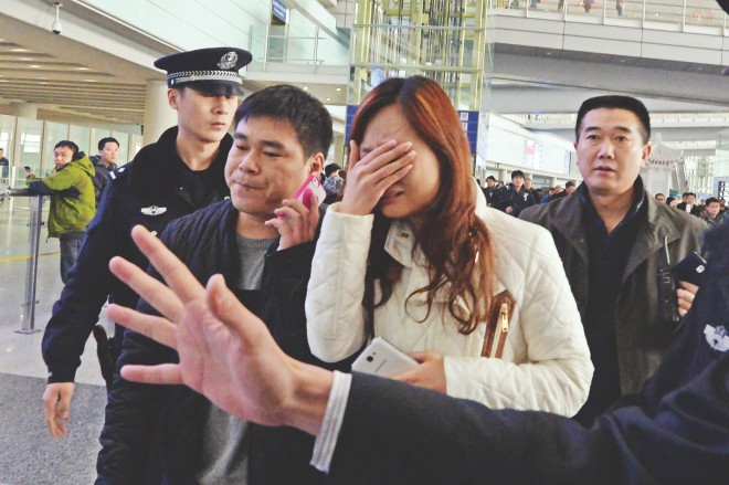 A relative cries at the Beijing Airport after news of the missing Malaysia Airlines Boeing 777-200 plane in Beijing, yesterday. Malaysia Airlines said a flight carrying 239 people from Kuala Lumpur to Beijing went missing early yesterday near the in the waters of southern Vietnam en routr to Beijing. All on board were presumed dead.  Photo: AFP