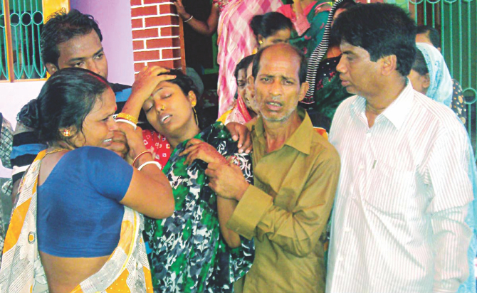 Relatives try to console Jyotsna Rani as she mourns 11 people killed in a bus-train collision in Jhenidah's Kaliganj on Friday. It was from her wedding that the victims were returning. Photo: Banglar Chokh