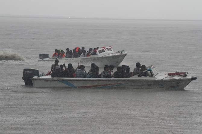 Rescue team members with speedboats are searching for missing victims in Pinak-6 launch capsize Wednesday afternoon. The launch with 200 passengers onboard sank in the Padma river of Lauhajang upazila in Munshiganj Monday. Photo: STAR