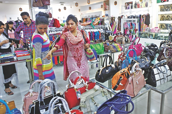 Customers take a look at handbags on display at the Infinity Mega Mall at Bashundhara City in Dhaka ahead of Eid festivities. Infinity opened a number of stores across the city to tap the biggest shopping season. Photo: Star