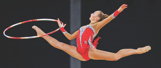Patricia Bezzoubenko of Canada performs during her hoop routine in the rhythmic gymnastics individual apparatus final at the 2014 Commonwealth Games in Glasgow yesterday. The Canadian won gold in hoop, ball and clubs. Photo: Reuters