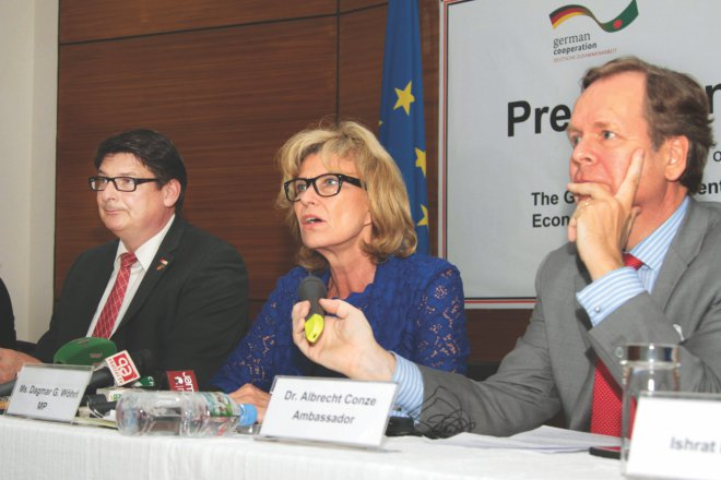 Middle, Dagmar G Woehrl, head of the German parliamentary delegation, speaks at a press briefing at German House in the capital yesterday. Stefan Rebmann, a German lawmaker and Albrecht Conze, German ambassador to Bangladesh, were also present. Photo: Star