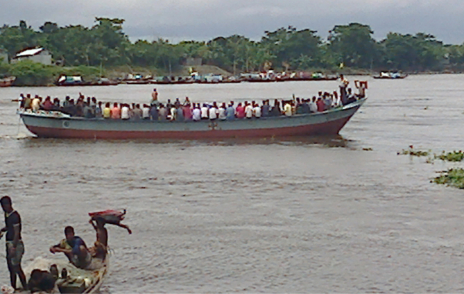 As Eid holidays ended, people from different areas of Bhola district are returning to their workplaces, crossing the Megna River in risky small vessels due to transport crisis. This photo was taken from near Bhola-Laxmipur ferry terminal yesterday. Photo: Star