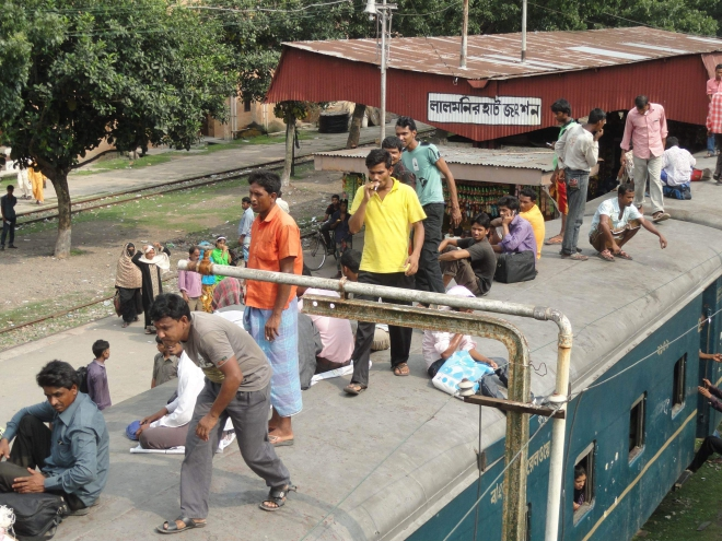 People often ride on the train roof putting their lives at risk due to shortage of carriages on Lalmonirhat-Burimari route. Photo: Star