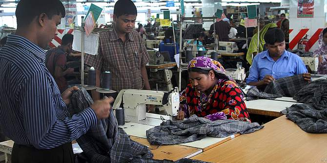 This May 17, 2013 photo shows employees working in a garment factory of Ashulia, an outskirt area of the capital, Dhaka.