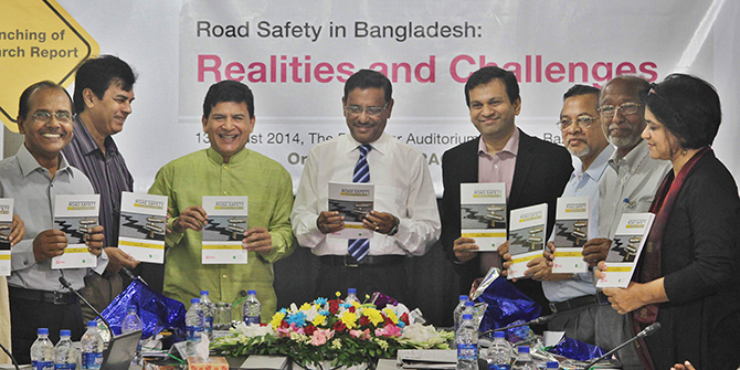 Communications Minister Obaidul Quader (fourth from left) at a programme on road safety at The Daily Star newspaper office in Dhaka today . Photo: Star