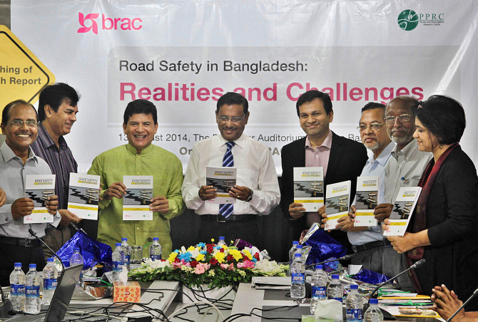 "From left, Ahmed Najmul Hussain, Ilias Kanchan, Hossain Zillur Rahman, Obaidul Quader, Asif Saleh, Humayun Kabir Chowdhury, Abdul Haq, and Sara Hossain hold the copies of the research report, ""Road Safety in Bangladesh: Realities and Challenges"", during its unveiling ceremony at The Daily Star Centre in the capital yesterday. Brac, and Power and Participation Reseach Centre (PPRC) conducted the study. Photo: Star"