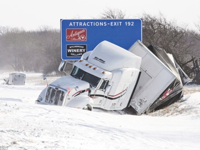 A semi truck sits in the ditch on the eastbound side of I-74 west of St Joseph, Illinois, on Monday amid sub zero temperatures. Photo: AFP