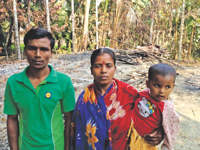 Krishna Haldar and his family standing before their home burnt to the ground at Gabtola Shikdermallik union in Pirojpur. Robbers, allegedly blessed by 18-party alliance men, torched their home during a blockade on December 5.    Photo: TAWFIQUE ALI