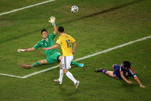 James Rodriguez of Colombia shoots and scores his team's fourth goal past goalkeeper Eiji Kawashima of Japan during the 2014 FIFA World Cup Brazil Group C match between Japan and Colombia at Arena Pantanal on June 24, 2014 in Cuiaba, Brazil. Photo: Getty Images