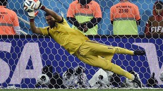 Sergio Romero of Argentina saves the penalty kick of Wesley Sneijder of the Netherlands (not pictured) in a shootout during their semi-final match at The Corinthians Arena in Sao Paulo on July 9, 2014.