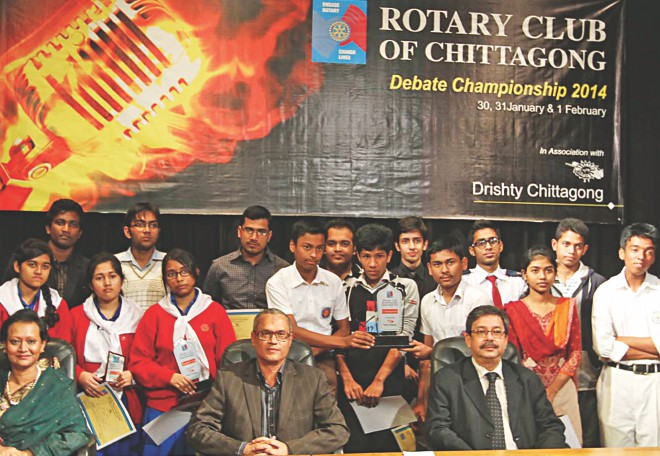 "Guests with awardees of a three-day ""Rotary Club of Chittagong Debate Championship 2014"", organised by Rotary Club of Chittagong in association with Drishti, Chittagong, at Theatre Institute in the port city yesterday. Photo: Star"