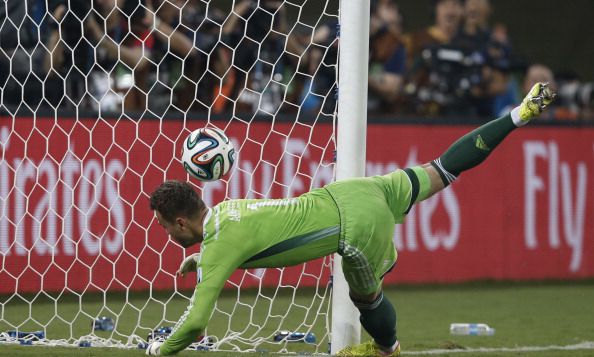 Russia's goalkeeper Igor Akinfeev fails to save the 0-1 goal during the Group H football match between Russia and South Korea in the Pantanal Arena in Cuiaba during the 2014 FIFA World Cup. Photo:AFP/Getty Images