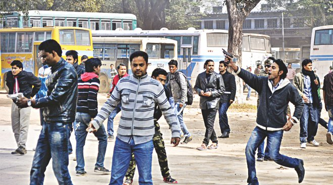 Brandishing handguns, Chhatra League cadres attack the students demonstrating against fee hike and evening shift on Rajshahi University campus yesterday.  Photo: Star