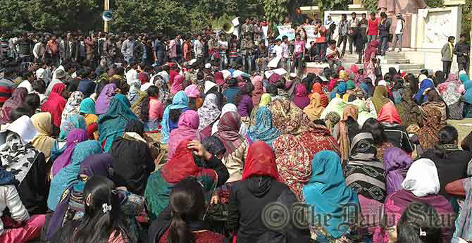 In this February 1 photo, over 5,000 students of Rajshahi University gather at a protest rally at Shabash Bangladesh play grounds on the campus demanding immediate withdrawal of hiked fees and cancellation of evening master's courses.