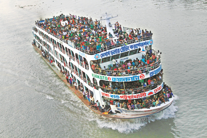 A launch leaves Dhaka with hundreds of people on board, eager to meet family members and spend the Eid holidays. The photo was taken from Postogola bridge on the river Buriganga yesterday. Photo: Amran Hossain