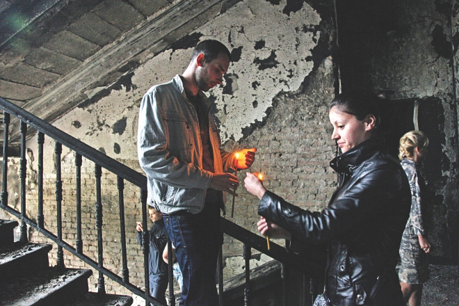 People hold candles as they mourn inside the burned trade union building in the southern Ukrainian city of Odessa yesterday. Photo: AFP